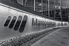 MPG (CJ Schmit) Tags: usa building monochrome sign wisconsin architecture canon logo concrete rocks unitedstates milwaukee toned manpower bradystreet corporateoffices canonef1740mmf40lusm 5dmarkii canon5dmarkii cjschmit wwwcjschmitcom niksilverefexpro2 manpowergroup cjschmitphotography