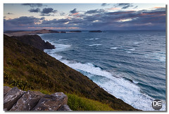 moody evening (Darkelf Photography) Tags: new sunset sea clouds canon landscape island photography evening rocks tripod north zealand filter nz cape tasman maciek reinga 2011 darkelf 24105mm moodyevening 5dii gornisiewicz