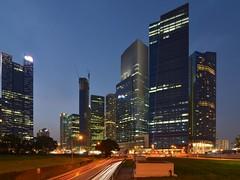 Marina Bay Finance Centre from beside ECP (Nicolas Lannuzel) Tags: street city night buildings lights singapore asia dusk lighttrails tokina1224mmf4 nikond7000 marinabayfinancecentre