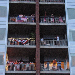 high.rise.perch  fireworks.watching (origamidon) Tags: usa architecture burlington square vermont highrise balconies condos july4th sq vt redwhiteblue bunting batterystreet 04501 greenmountainstate chittendencounty origamidon donshall burlingtonvermontusa