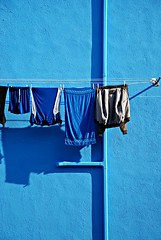 sunny day (burano - venice, italy) (bloodybee) Tags: street blue venice shadow italy house wall facade europe tube pipe tshirt sunny towel rope clothes jacket laundry hanging shorts clothesline washing burano sunnyday hanginglaundry
