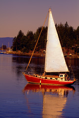 I'd Rather Be Sailing (Peggy Collins) Tags: ocean sunset sea canada mountains reflection water sailboat islands bay boat sailing harbour britishcolumbia pacificocean pacificnorthwest sunshinecoast waterreflections woodensailboat redsailboat peggycollins