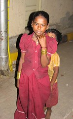 girl.with.brother (lukelucasholland) Tags: poverty india housing mumbai humanrights slum sanitation socialrights mdgs dharavi millenniumdevelopmentgoals economicrights