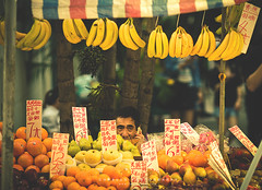 Fruit Stage (Chalres Wonderland*) Tags: life street people fruit canon stand phone bokeh sale traditional cell talk 365 moment macau fruitstand cinematic onsale 135mm canonef135mmf2lusm 60d