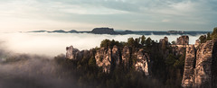 Saxony Switzerland - Bastei Sunrise (claudecastor) Tags: schsischeschweiz sachsen saxonyswitzerland saxony landscape schrammsteine schrammsteingebirge landschaft natur nature mountains elbsandsteingebirge diebastei bastei panorama morning light morgen licht dmmerung sonnenaufgang sunrise nebel fog foggy neblig historisch misty knigstein castle schloss lilienstein tafelberg wald wehlnadel