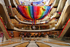 Fun City Mall, Bishkek, Kyrgyzstan. (Malinki_Malinki) Tags: mall shoppingmall bishkek kyrgyzstan perspective colors colours angle posh business shapes people fun commerce clean shiny shining new wellkept wellmaintained interesting sony