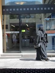 Not a robbery... (vittorio vida) Tags: woman sarajevo black burqa abaya niqab muslim islam dress street bank robbery religion tradition balkans portrait peopleveil