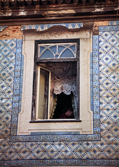 Everything is there so much time... except the Girl (Ninoo Vita) Tags: nikonf100 afnikkor2885mm13545 fujicolor100 nikon nikkor fuji color lisbon portugal analogic film colorfilm window curtains everything girl building old time