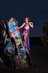 Kate Reynolds at the Amarillo Cadillac Ranch (Mitch Tillison Photography) Tags: beautiful gorgeous pretty amazing sexy female model redhead ginger bellydancer burlesque amarillo cadillacranch dusk lowlight strobe nikon d5 iso800 godox wistro ad360 tamron70200 portrait photo photography mitchtillison