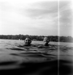 Swimming in Spring (horacekenneth) Tags: blackandwhite bw lake cold 6x6 film water swimming swim mediumformat river spring scan april mf darkwater 2012 developing neopanacros100 superikonta52016 picturefromthewater