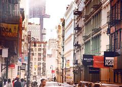 Top of the World (mheidelberger2000) Tags: nyc newyorkcity people urban fashion architecture commerce manhattan soho watertower historic neighborhood crop castiron fireescape overexposed gothamist lowermanhattan businesses 5x7 oneworldtradecenter