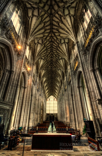HDR down the nave of Winchester Cathedral. The building was consecrated in 1093. Under William of Wykeham (1367-1404) the Romanesque nave was transformed, recased in Caen stone and remodelled in the Perpendicular style.