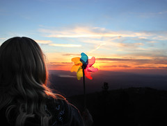 (skyekz) Tags: california sunset summer portrait sky orange playing mountains girl beautiful childhood wheel clouds spiral fun toy creativity person one kid spring holding colorful hand unitedstates wind joy longhair tranquility happiness spinning blonde idyllwild pinwheel cheerful multicolored playful enjoyment turning oneperson whimsical adolescence