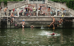 Old Men Swimming (Jonathan Kos-Read) Tags: china yellow swim river beijing   aftertherain fins oldmen goodlife bluecap goldenratio   beijinglife 135mmf2dc beijingstreet 135mmf2ddc  beijingriver nikon135mmf2dclens iceboxcool nikkor135mmaff2dc