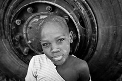 Hausa young boy in front of a truck, Inyelwa - South Niger - (C.Stramba-Badiali) Tags: africa niger afrique christophestrambabadiali
