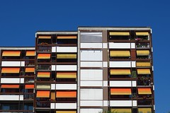 in the heat of summer (Riex) Tags: ete summer facade immeuble batiment building apartments appartements locatif tentes tents sunny ensoleille balcony balcons lausanne vaud switzerland suisse g9x