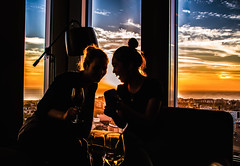 Silhouettes and sunset at Malm Live Skybar (Maria Eklind) Tags: utsikt ljus glass cityview view color sunset restaurant himmel city silhoutte malmhattan moln malm sky light clouds europe malmlive silhuett solnedgng skybar people bar skneln sverige se