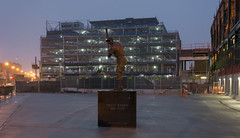 Mr. Cub wouldn't recognize the place. (urbsinhorto1837) Tags: 2016 chicago chicagocubs clarkaddison construction dawn erniebanks fog may overcast spring wrigleyfield wrigleyville statue