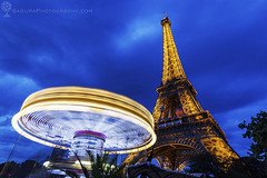 Eiffel Tower and carousel in Paris (hsadura) Tags: champdemars eiffeltower europe france merrygoround stephensauvestre town architecture blue blur building carousel city citycenter cityscape darkness dawn downtown dusk evening famous illuminated landmark latticetower night oldtown outdoors panorama sky skyline square street streetlight tower travel urban