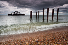 West Pier (Olly Plumstead) Tags: ocean sea summer england seascape motion blur west water june metal canon landscape pier rust brighton moody mark south wave stormy pebbles burnt ii 5d olly derelict destructive atmospheric breaking swash 1740l plumstead 5d2 mygearandme mygearandmepremium mygearandmebronze mygearandmesilver mygearandmegold mygearandmeplatinum mygearandmediamond backswash