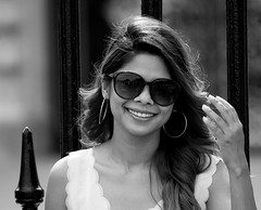 The Smile (Candid Street Portrait Photography) (Loc BROHARD) Tags: street portrait blackandwhite bw woman girl smile hair photography glasses women candid streetportrait earing candidportrait streetcandid