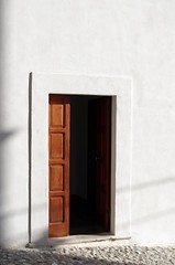 gateway (SS) Tags: camera light vacation italy brown white black building church june vertical wall composition contrast photography mood shadows angle pentax pov walk perspective framing minimalism bianco nero tone puglia ambience k5 gargano peschici costaadriatica opposti