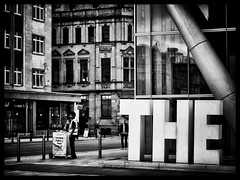 The The (Feldore) Tags: street england news man english manchester stand newspaper big letters surreal vendor selling mchugh seller feldore