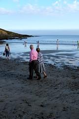 (Callum O' Keeffe) Tags: pink blue ireland sea brown green beach water shirt 35mm lens photography evening inch couple rocks warm fuji cork sunny x cliffs east elderly fujifilm aged sands xe1