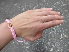 Good luck bracelet from the monk at Wat Chakrawatrachawat Woramahawihan (eltpics) Tags: eltpics thailand bangkok bracelet pink lucky luckycharm goodluck superstition hand