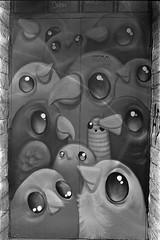 Spot the worm... (the_anachronist) Tags: graffiti birds selfdeveloped building urban life wall door doorway church bw monochrome ilfords ilford hp5 iso400 nikon f55 nikkor 50mm f18d 35mm film istillshootfilm filmisnotdead