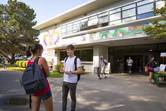 International students Sabine Mauguiere from France, left, and Stefan Moderau from Germany chat in front of Lassen Hall before their 10 a.m. class. (Sac State) Tags: public affairs california state university sacramento vernone sacstate sacramentostate calif usa us