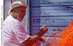 Doug Mummery, Mending Nets (jwvraets) Tags: dougmummery dougraynetmending portrait working portdover fishnet mending orange opensource luminance rawtherapee gimp nikon d7100 nikkor18105mmvr