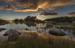 Sunset - D8E_4337 (Viggo Johansen) Tags: sunset sun clouds blue yellow trees lake rocks mountains evening holmavatn bjerkreimkommune rogaland norway reflections