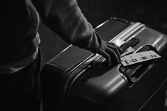 Brand New Bag (Florian Btow) Tags: travel suitcase hand luggage man black bag street white young city light new holding guard close up