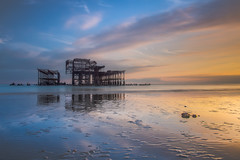Standing still (lloydich) Tags: west pier brighton sussex lowtide blue beach sand