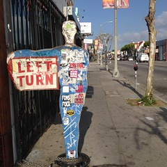 Left Turn (Lucyrk in LA) Tags: california park ca street art sign turn walking point outside outdoors person photography drive la losangeles sticker driving photographer outdoor parking stickers sidewalk photograph melrose hollywood graffitti april p meter shape left meters apr wal laist lucyrkinla