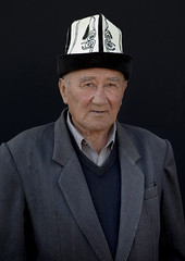 Old Man With A Kalpak Hat At The Animal Market In Kochkor, Kyrgyzstan (Eric Lafforgue) Tags: old people man male hat vertical standing person one asia interior elder wisdom centralasia kyrgyzstan wrinkles humanbeing oneperson colorphoto headgear kochkor kyrgyzrepublic 1260 kirghizistan kirgistan kalpak lookingatcamera waistup kirghizstan kirgisistan traditionalhat calpack  calpac   traditionalheadgear quirguizisto kalpakhat kalpac qalpaq