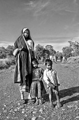 Toranmal Photography - A Mother and Two Children and a Flock of Cows - Monochrome (Anoop Negi) Tags: portrait india rural photography for cow photo media village child delhi indian agrarian bangalore creative mother tribal best po maharashtra mumbai herd anoop agricultural negi ezee123 toranmal jjournalism