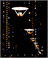 Lights after dark (Ksung) Tags: street blue windows light red white black building tower lamp yellow vertical metal night contrast canon circle 50mm star streetlight streetlamp residence lightball capturethefinest