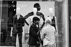 Asymmetric 2 way sandwich. (Adeypoos) Tags: silverefex candid straatfoto street people bw adrianpollardphotography symmetry blackandwhite fujix100 streetphotography asymmetry