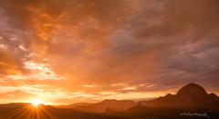 Bathed in Orange (TreeRose Photography) Tags: sedona arizona rocks mountains landscape scenery southwest sky stormy storm monsoon rain evening summer orange glow sunstar light rays silhouettes