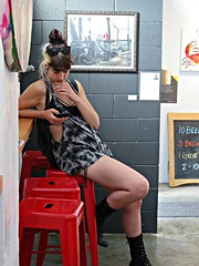 Slouching and Texting (knightbefore_99) Tags: slouch pose cell dumb sad pathetic lonely text mobile phone idumb bar callisters eastvan vancouver west coast