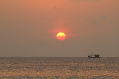 Fishing boat sunset (KENO Photography) Tags: asia asian bali beach fishing boat calm evening horizon indonesia jimbaran nature nobody ocean orange relax sea shore sky summer sun sunset bay seaside outdoor landscape vehicle sand waves