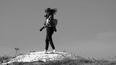 Dance in the wind (patrick_milan) Tags: noiretblanc blackandwhite noir blanc monochrome nb bw black white street rue people personne gens streetview fminin femal femme woman women girl fille belle beautiful portrait face candide photographer plouguin wind saintpabu vent hair