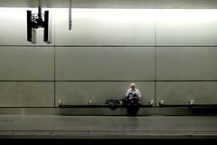 the reader (Bob_Last_2013) Tags: reading books railwaystation alone