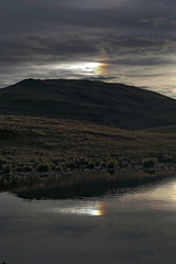 Sun Dogs (Robyn Hooz) Tags: sundog parelio riflesso reflection nuvole clouds arcobaleno rainbow acqua specchio mirror dolomiti dolomites