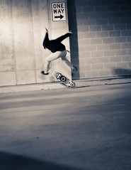 (diana.randles) Tags: skater skateboard oneway action midair friend concrete parkinggarage hooligan youth freezeframe motion motionblur blurry