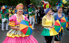 Parasols (englishreader) Tags: nottinghamcaribbeanfestival caribbeanfestival festival nottingham costume colour color colours colors brightcolours brightcolors colourful colorful women woman female lady ladies younglady youngwoman band parasol parasols umbrella headdress drummers drummer drum drums flowers pink yellow green blue black streetphotography street people peoplephotography ribbons feathers feather daylight availablelight outdoors outdoor outside