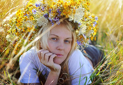 Beautiful young blonde woman with flower wreath on head in summer outdoors. (marozn) Tags: flower slavic blonde wreath woman summer outdoor gorgeous leisure fun attractive park female fashion portrait face ukrainian green spring care serenity art field grass ukraine mountains outside light freedom satisfaction people smile rest lifestyle emotion young girl vitality free relax beauty joy enjoyment sensuality carefree beautiful nature seductive pretty happy
