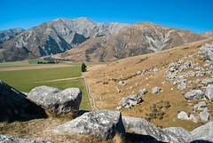 Follow the Path (Jocey K) Tags: blue light newzealand sky mountains tree grass rocks path canterbury hills nz limestone southisland pathway rockformations highcountry eroded castlehillbasin